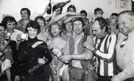 Brighton & Hove Albion Celebrate Promotion To The First Division. Manager Alan Mullery Is Soaked In Champagne