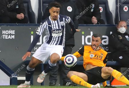 West Bromwich Albion's Matheus Pereira, left, and Wolverhampton Wanderers' Romain Saiss challenge for the ball during an English Premier League soccer match between West Bromwich Albion and Wolverhampton Wanderers at The Hawthorns in West Bromwich, England. The status of the most lucrative soccer league in Asia for players is moving from China to Saudi Arabia. Oscar's move from Chelsea in 2016 to Shanghai Port for almost $100 million prompted warnings from the the London club's coach. Now Oscar is one of the few big names left in the Chinese Super League. Al-Hilal of Riyadh beat European clubs earlier this month to sign Brazilian playmaker Matheus Pereira from West Bromwich Albion