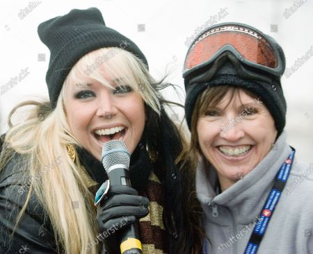 Singer Suizie McNeil (L) mingles with the audience while performing at the FIS Freestyle World Cup events on Cypress Mountain a 2010 Winter Olympic venue overlooking Vancouver, British Columbia, February 9, 2008. McNeil is best known as the last woman standing on the CBS reality series Rockstar, INXS.