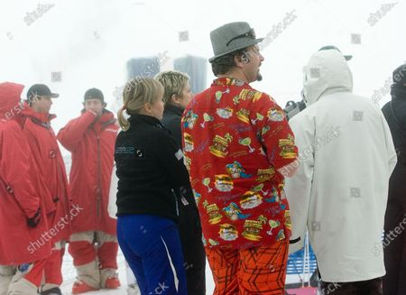 Stock Photo of With fog and rain suspending competition a spectator in a Hawaii shirt listens to the performers onstage at the FIS Freestyle World Cup events on Cypress Mountain a 2010 Winter Olympic venue overlooking Vancouver, British Columbia, February 9, 2008.