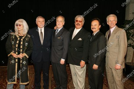 From left to right, Emmylou Harris, Tom T. Hall, Don Reid, Harold Reid, Jimmy Fortune, and Phil Balsley, pose for photos after being introduced as the class of 2008 Country Music Hall of Fame Inductees at the Country Music Hall of Fame in Nashville, Tennessee on February 12, 2008.