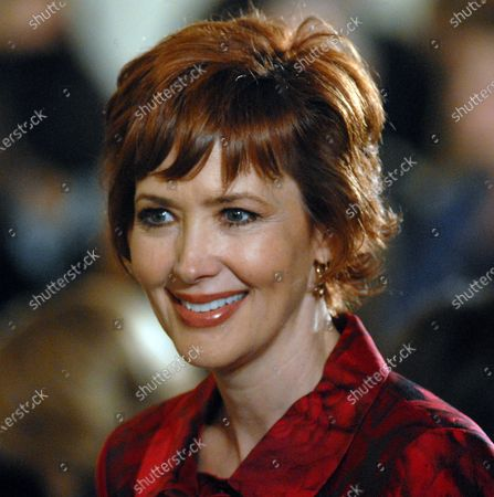 Actress Janine Turner attends a ceremony in honor of Women's History Month and International Women's Day in the East Room of the White House in Washington on March 10, 2008.