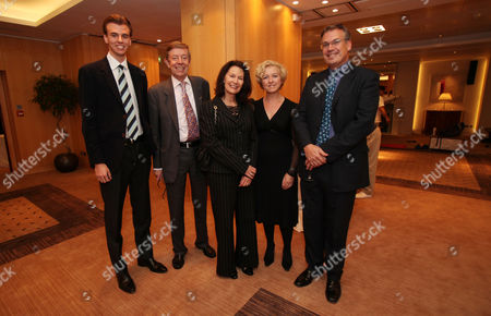 Henry Kelly (2L) with son Alexander and wife Karolyn, with Anne Nicholas and Alasdair McWhirter