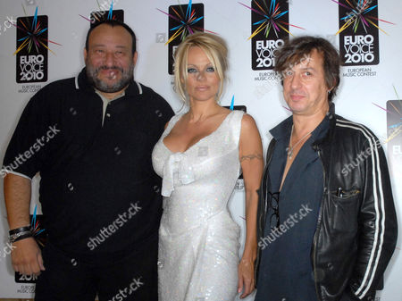 Pamela Anderson with Greek producer Miltos Karatzas and Eric Serra the composer and President of the contest.