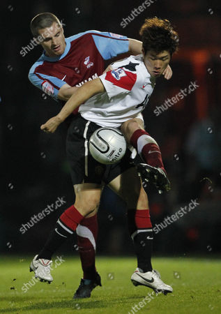 Andrew Wright of Scunthorpe United and Ji Sung Park of Manchester United
