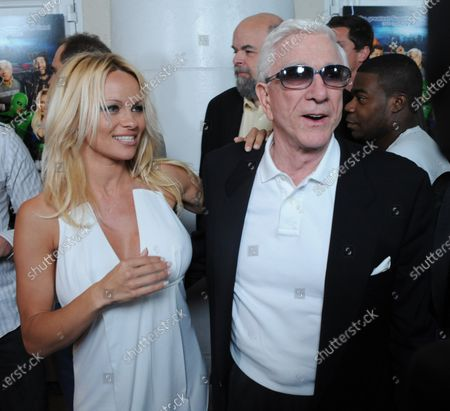 """Pamela Anderson and Leslie Nielsen, cast members in the motion picture parody spoof """"Superhero Movie,"""" attend the premiere of the film in Los Angeles on March 27, 2008."""