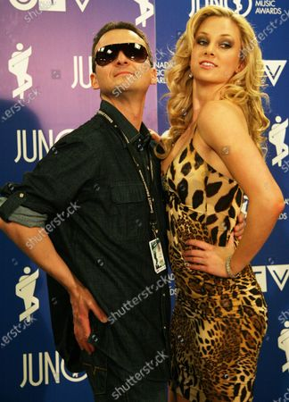 Photographer Todd Koro gets his picture taken backstage with glamourous comedian Nicole Arbour (R) during the 2008 Dinner and Awards Gala at the Calgary Telus Convention Cente during the JUNO Awards in Calgary, Alberta, April 5, 2008.