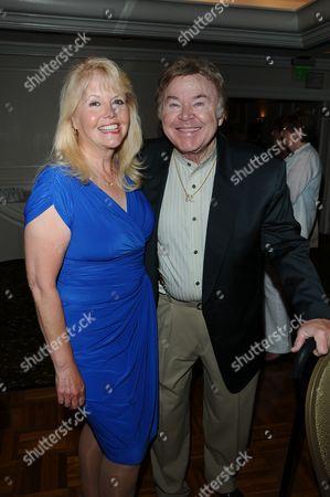 Misty Rowe and Roy Clark