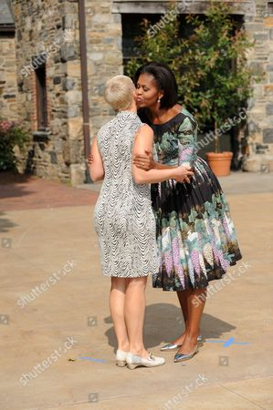 United States First Lady Michelle Obama, right, and Evelin Ilves of Estonia