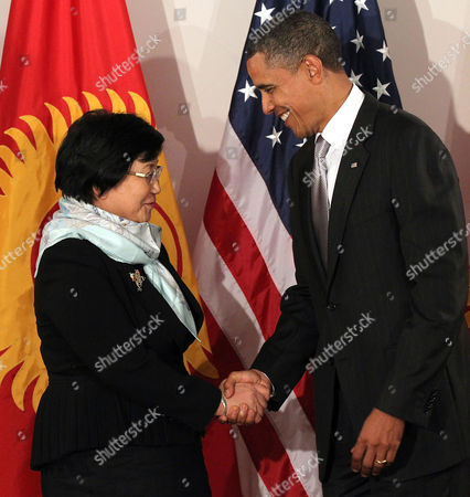 United States President Barack Obama shakes hands at a bilateral meeting with President of Kyrgyzstan Roza Otunbaeva