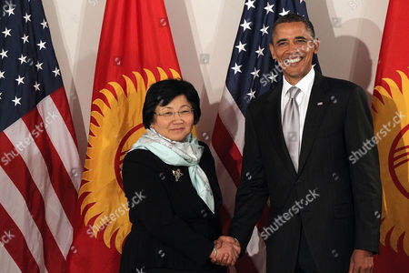 Stock Picture of United States President Barack Obama shakes hands at a bilateral meeting with President of Kyrgyzstan Roza Otunbaeva
