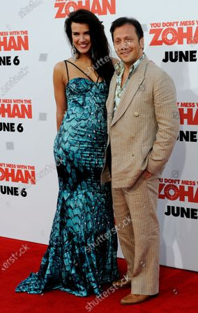 """Rob Schneider, a cast member in the motion picture comedy """"You Don't Mess With the Zohan"""", attends the premiere of the film with Natalia Guslistaya at Grauman's Chinese Theatre in the Hollywood section of Los Angeles on May 28, 2008."""