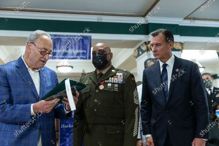 Senator Chuck Schumer, elected officials honor members of 369th Regiment and The Harlem Hellfighters and Harlem Armory. Senator Schumer annonced Congressional Gold Medal awarded to Harlem Hellfighters and presented The Legion of Merit Award from the US Senate to Command Sergeant Major Andrew Lampkins. Schumer was joined by elected officials U.S. Representatives Tom Suozzi and Adriano Espaillat, former U.S. Representative Charles Rangel, NYS Senator Brian Benjamin, NYS Assemblymembers Inez Dickens and Al Taylor, as well as family members of the Harlem Hellfighters. In this photo Senator Schumer, Command Sergeant Major Andrew Lampkins and Tom Suozzi.