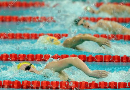 Australian Bronte Barratt, Slovakian Sara Isakovic, Britain's Caitlin McClatchey and Frances Ohelie-Cyrielle Etienne (L to R) compete in the Women's 200 Meter Freestyle heat number 5 at the National Aquatic Center (Water Cube) during the 2008 Summer Olympics in Beijing, China, on August 11, 2008.