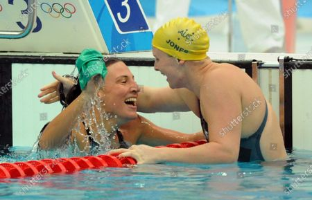 Australia's gold medal winner Leisel Jones is congratulated by bronze medalist Austria's Mirna Jukic (L) after they finished the Women's 100M Breaststroke at the National Aquatics Center at the Summer Olympics in Beijing on August 12, 2008.  Jones set an Olympic Record with 1:05.17.