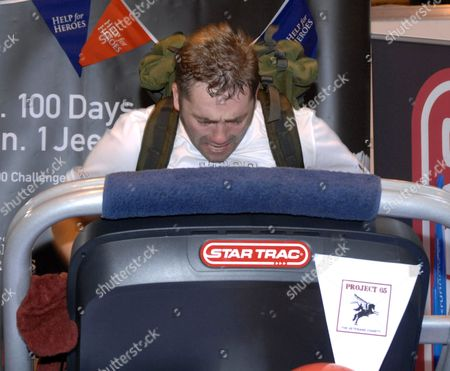 Editorial picture of Mike Buss finishes his 100th marathon in 100 days at the NEC, Birmingham, Britain - 23 Sep 2010