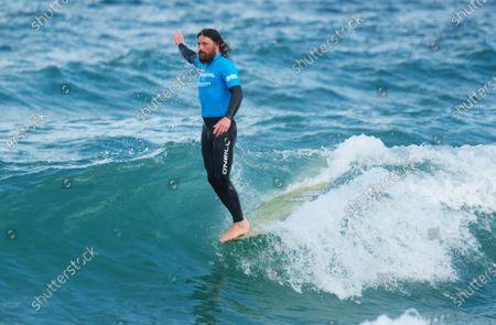Ben Skinner surfing in the Heat 2 Quarterfinals of Men's Longboard at Boardmasters held on Fistral Beach.