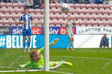 Wigan Athletic goalkeeper Ben Amos (12)makes a save during the EFL Sky Bet League 1 match between Wigan Athletic and Rotherham United at the DW Stadium, Wigan