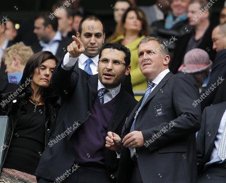 Manchester City chairman Khaldoon Al Mubarak points next to chief executive Garry Cook