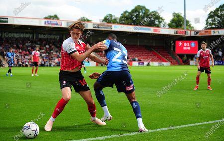 Callum Wright of Cheltenham Town tries to hold off Jordan Obita of Wycombe Wanderers- Mandatory by-line: Nizaam Jones/JMP