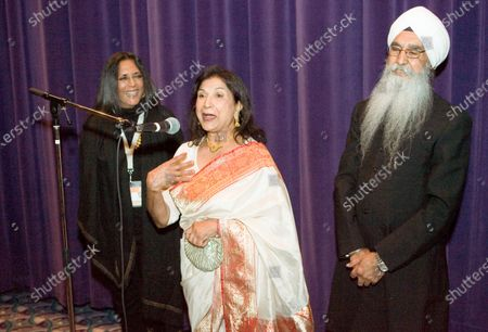 """Writer/director Deepa Mehta (L) invites local actors Balinder Johal and Rajinder Singh Cheema (R) to the microphone to help her introduce their latest film """"Heaven on Earth"""" screening at the Empire Granville 7 Theater during the Vancouver International Film Festival in Vancouver, British Columbia, October 4, 2008."""