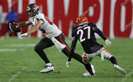 Tampa Bay Buccaneers tight end Tanner Hudson (88) makes a catch in front of Cincinnati Bengals defensive back Tony Brown (27) during the first half of an NFL preseason football game, in Tampa, Fla