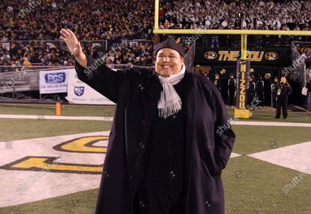 """Neal Boyd, a 2001 graduate of the University of Missouri and winner of NBC's """"America's Got Talent"""" waves to the crowd as he is introduced during the Kansas State -Missouri football game at Faurot Field in Columbia, Missouri on November 8, 2008."""