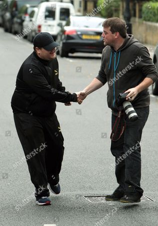Stock Picture of James Corden and photographer Carl Sims