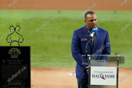 Retired Texas Rangers player Adrian Beltre speaks during a ceremony before a baseball game against the Oakland Athletics in Arlington, Texas, . Beltre and team public address announcer Chuck Morgan were inducted into theRangers' Hall of Fame on Saturday