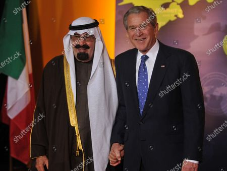 Stock Picture of U.S. President George W. Bush welcomes King Abdullah bin Abd al-Aziz Al Saud of Saudi Arabia to the Summit on Financial Markets and the World Economy leaders at the National Building Museum in Washington on November 15, 2008.