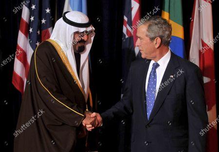 U.S. President George W. Bush welcomes King Abdullah bin Abd al-Aziz Al Saud of Saudi Arabia to the Summit on Financial Markets and the World Economy leaders at the National Building Museum in Washington on November 15, 2008.