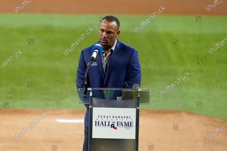 Stock Image of Retired player Adrian Beltre makes comments during a pregame ceremony before a baseball game between the Oakland Athletics and Texas Rangers in Arlington, Texas, . Beltre and team public address announcer Chuck Morgan were inducted into the team's hall of fame
