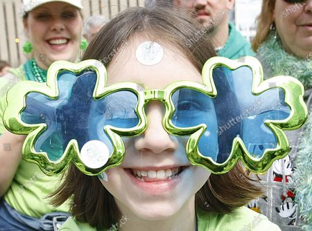 Jennifer Wilson (10) shows off her Irish heritage with her oversized sunglasses as she watches the St. Patricks Day parade in downtown St. Louis on March 15, 2008.