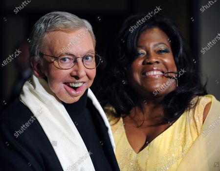 Film critic Roger Ebert and his wife Judge Chaz Hammelsmith arrive at the 61st annual Directors Guild of America Awards in Los Angeles on January 31, 2009.