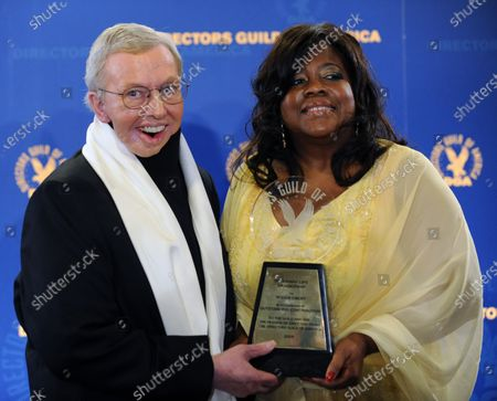 Film critic Roger Ebert appears backstage with his wife Judge Chaz Hammelsmith after receiving the Honorary Life Membership Award at the 61st annual Directors Guild of America Awards in Los Angeles on January 31, 2009.