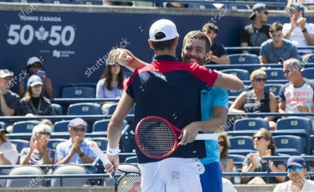 Stock Image of (210815) - TORONTO, Aug 15, 2021 (Xinhua) - Mate Pavic and Nikola Mektic (back) of Croatia celebrate victory after their semifinal of men's doubles match against Kevin Krawietz of Germany and Horia Tecau of Romania at the 2021 National Bank Open in Toronto, Canada, on Aug 14, 2021.