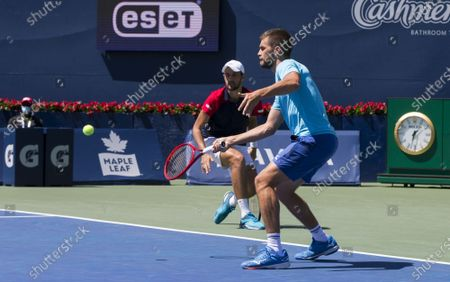 Stock Photo of (210815) - TORONTO, Aug 15, 2021 (Xinhua) - Mate Pavic and Nikola Mektic (R) of Croatia compete during the semifinals of men's doubles matches against Kevin Krawietz of Germany and Horia Tecau of Romania at the 2021 National Bank Open in Toronto, Canada, on Aug 14, 2021.