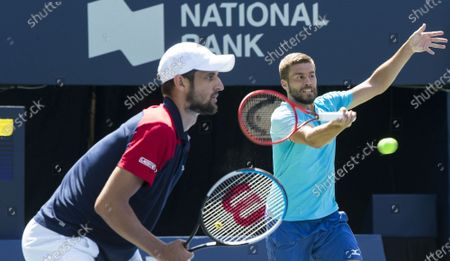 (210815) - TORONTO, Aug 15, 2021 (Xinhua) - Mate Pavic and Nikola Mektic (R) of Croatia compete during the semifinals of men's doubles matches against Kevin Krawietz of Germany and Horia Tecau of Romania at the 2021 National Bank Open in Toronto, Canada, on Aug 14, 2021.