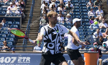 (210815) - TORONTO, Aug 15, 2021 (Xinhua) - Kevin Krawietz (L) of Germany and Horia Tecau of Romania compete during the semifinals of men's doubles match against Mate Pavic and Nikola Mektic of Croatia at the 2021 National Bank Open in Toronto, Canada, on Aug 14, 2021.