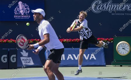 Stock Picture of (210815) - TORONTO, Aug 15, 2021 (Xinhua) - Kevin Krawietz (R) of Germany and Horia Tecau of Romania compete during the semifinals of men's doubles match against Mate Pavic and Nikola Mektic of Croatia at the 2021 National Bank Open in Toronto, Canada, on Aug 14, 2021.