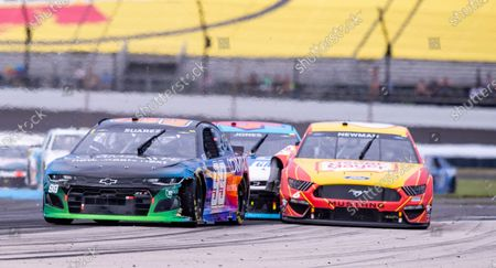 The car of Ryan Newman (6), right, makes contact with the car driven by Erik Jones (43), center, at Turn 5 during a NASCAR Cup Series auto race at Indianapolis Motor Speedway, in Indianapolis