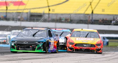 The car of Ryan Newman, right, makes contact with the car driven by Erik Jones (43), back center, at Turn 5 during a NASCAR Cup Series auto race at Indianapolis Motor Speedway, in Indianapolis