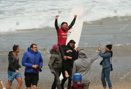 Stock Picture of Ben Skinner wins the Boardmasters Men's Longboard. Held at Fistral Beach.
