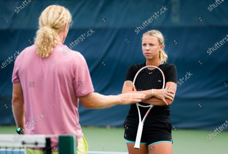 Anett Kontaveit of Estonia with coach Dmitry Tursunov during practice ahead of the 2021 Western & Southern Open WTA 1000 tennis tournament