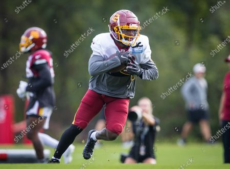 Washington Football Team wide receiver Tony Brown (12) runs the ball up field during the team's NFL football training camp practice at the Washington Football Team Facilities in Ashburn, Virginia Photographer: Cory Royster