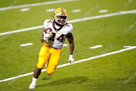 Minnesota running back Mohamed Ibrahim runs for a touchdown against Maryland during the first half of an NCAA college football game, in College Park, Md. Many of Minnesota's upperclassmen cashed in on the bonus year of eligibility after the pandemic and returned for 2021, giving the Gophers one of the oldest teams in the Big Ten. The time is now for coach P.J. Fleck's group to take another step forward, led by running back Mo Ibrahim and quarterback Tanner Morgan, both in their fourth year