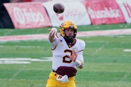 Stock Photo of Minnesota quarterback Tanner Morgan (2) throws during the first half of an NCAA college football game against Nebraska in Lincoln, Neb., . Many of Minnesota's upperclassmen cashed in on the bonus year of eligibility after the pandemic and returned for 2021, giving the Gophers one of the oldest teams in the Big Ten. The time is now for coach P.J. Fleck's group to take another step forward, led by running back Mo Ibrahim and quarterback Tanner Morgan, both in their fourth year