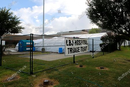 Covid-19 cases are surging in Texas especially among children. On August 12th, 2021, a new temporary tent building is seen attached by a long vestibule to the emergency entrance of Lyndon B. Johnson Hospital in Houston, Texas. This building is to help the new influx of covid-19 cases in the area but has not yet been staffed due to staffing shortages.
