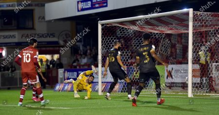 Stock Photo of Salford goalkeeper Tom King is beaten by Crawley's second goal scored by Jake Hessenthaler during the Sky Bet League Two match between Crawley Town and Salford City at the People's Pension Stadium  , Crawley ,  UK - 17th August 2021