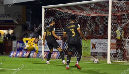 Salford goalkeeper Tom King is beaten by Crawley's second goal scored by Jake Hessenthaler during the Sky Bet League Two match between Crawley Town and Salford City at the People's Pension Stadium  , Crawley ,  UK - 17th August 2021